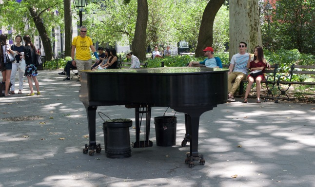Someone managed to bring this grand piano into the middle of the park. Some days there is famously another grand piano that is played under the iconic archway.