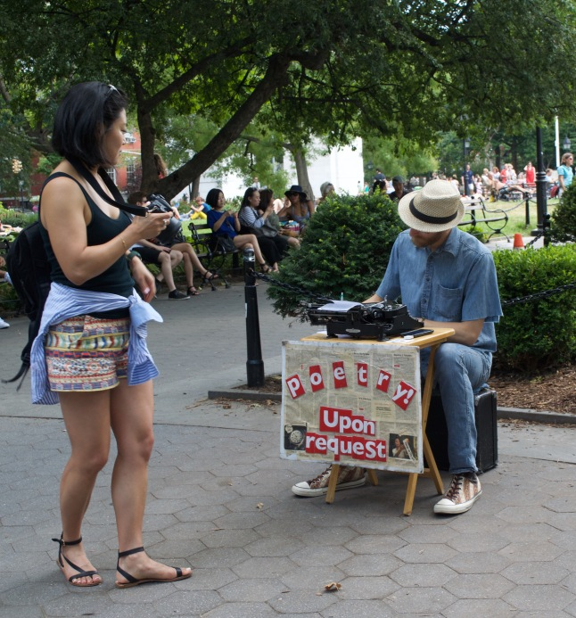 A fellow photographer checks out a man selling instant poetry for $10.